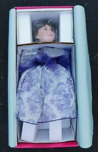 Marie Osmond Coming Up Roses Musical Marie 23-Inch on Bench Porcelain Doll