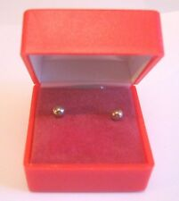 Lovely gold tone metal stud style earrings in red box approx 4 mm wide