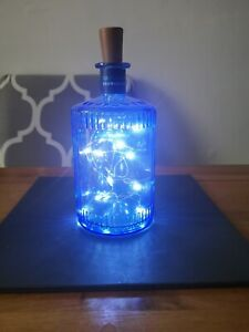 Glass gin bottle with lights