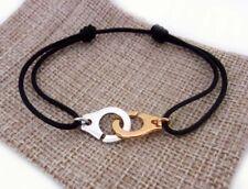 Bracelet menotte bicolore doré et argenté et cordon noir