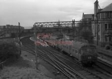 PHOTO  THE ABOVE UNIT NOW PASSED SID IS SEEN DRAWING INTO HELENSBURGH STATION RE