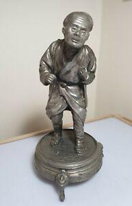 A Superb Meiji Period Silvered Metal Okimono Of A Old Man.