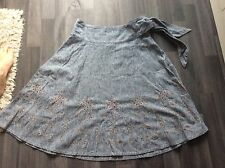 Next Denim look skirt size 10 waist measures 28 inches. Flower embroidery detail