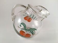 Vintage orange juice ball pitcher with ice lip tilted