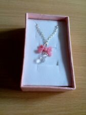 Pink bowknot water drop pendant necklace.