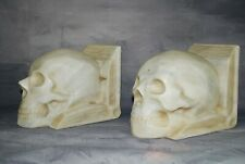 Marble skull bookends signed and dated by Brancusi