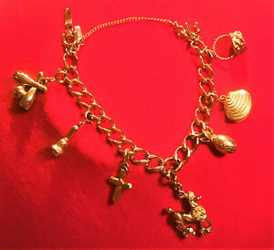Vintage MONET Gold Tone Charm Bracelet with 7 Charms, Excellent Condition!