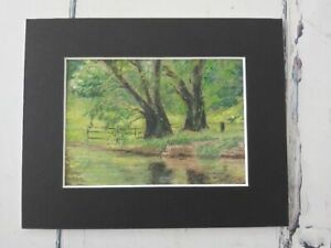 Mid 20thC original pastel of a woodland stream, in new black mount