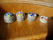 Four small silver metal boxes with glass millefiori lids.