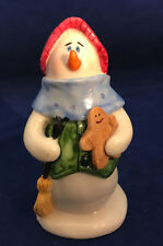 Nantucket Holiday Snowman Figurine holding a broom with a red hat on his head