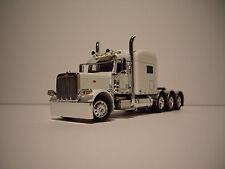 DCP 1/64 WHITE TRIAXLE 389 PETERBILT WITH 70'' MID-ROOF SLEEPER