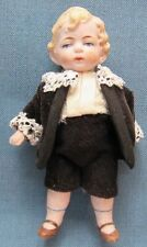 Vintage bisque boy doll in traditional European dress; movable arms & legs (6)