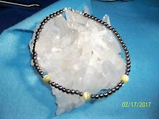 Magnetic hematite bracelet or anklet with yellow fiberoptic accents.