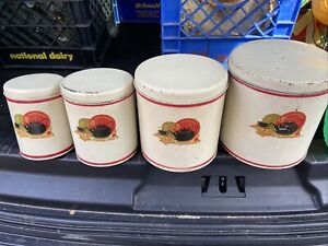 Set Of Four Vintage Kitchen Tins With Black teapot And Cup orange & green