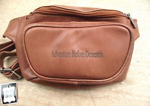 Brown leather bum bag with 'Adventure Before Dementia' etched into the leather