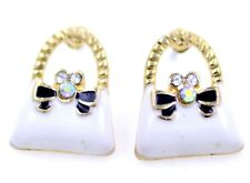 Gold tone white and black enamel bow and bag stud earrings