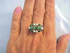 Vintage three stone emerald and diamond ring in 14K yellow gold