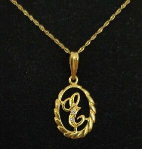 Colgante y cadena oro 18k. Inicial nombre letra E con circonitas