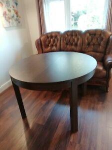 Ikea bjursta round extendable dining table dark walnut wooden 4-6 seater