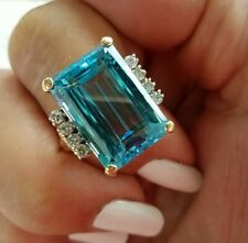 14KT Gold Blue Topaz 13x18mm with 8- 2.5mm Diamond ring pre owned size 8.5