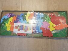Rainbow Woodden puzzle crocodile shape with alphabet letters and numbers
