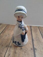 Jasco Ceramic Bell Girl Sitting holding Flowers Blue and White