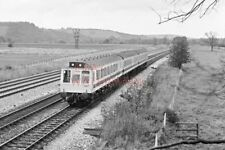 PHOTO  DMU UNIT L424 IN LIGHT COLOUR LIVERY AT  LOWER BASILDON 1977