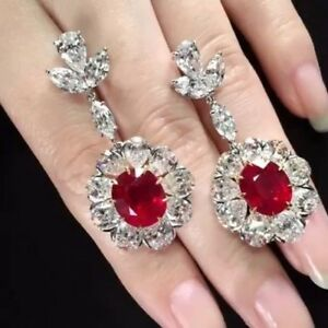 4Ct Oval Cut Ruby Simulnt Diamond Halo Chandelier Earrings White Gold Fns Silver