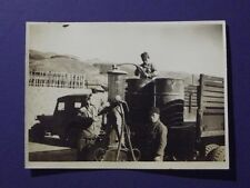 1947 PHOTO JAPANESE MEN IN OCCUPIED JAPAN FILLING GAS DRUMS ON BACK OF TRUCK