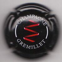 capsule de champagne GREMILLET, fond noir, dessin rouge, écriture blanche