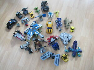 TRANSFORMERS VARIOUS FIGURES AND PARTS LOT OF 24 ZZ2102