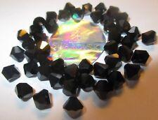 20 Swarovski Perlen 6 mmØ Jet, Hematite, schwarzl Schimmern # 5301-280  Effects
