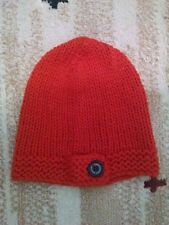 Harley Davidson orange knit hat with black H-D button on front.