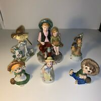Vintage Norleans brothers sitting Figurines.. Also combo of figurines Included!!