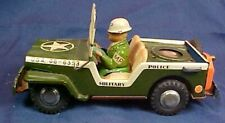Vintage Pressed Steel Military Police Jeep with Driver Friction Driven U.S.A.