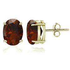 Gold Tone over Sterling Silver Garnet 8x6mm Oval Stud Earrings