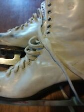 Vintage girl's ice skates - size 5. Good condition - black scuffs on skate.