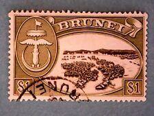 Brunei. QE2 1968 $1 Black & Bronze-Green. Wmk Ww12. SG129. P13. Used.