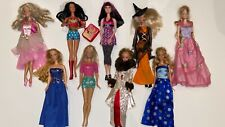 Mixed Lot of 9 Barbies with clothing