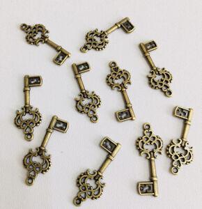 10 X Key Charms Steam Punk Alice In Wonderland Antique Bronze Jewellery Making