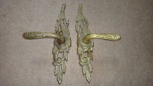 BRASS ORNATE DOOR HANDLES WITH KEYHOLE.