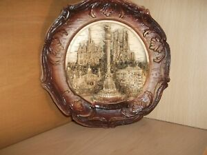 Barcelona wall plaque, brown and beige-coloured; 23 cms diameter.
