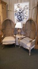 Pair of Porters Chairs with cushioned material seating and Wicker Tall Backs