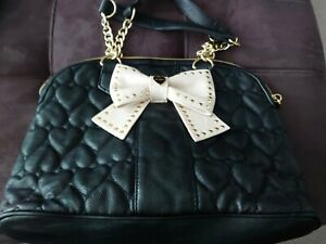 Betsey johnson black satchel with tan bow and gold hardware