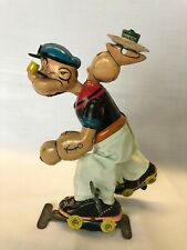 Linemar windup Popeye Roller Skating w/ Plate & can of Spinach TinToy Japan 1957