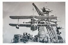 rp6385 - Walrus Seaplane being lifted on to HMS Rodney - photo 6x4