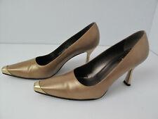 Stuart Weitzman  Gold Pumps with Gold Metal Toe design.Size 7.5 B