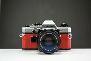 Olympus OM10 35mm Film Camera w/50mm f/1.8 Zuiko Lens Red Leather | Serviced