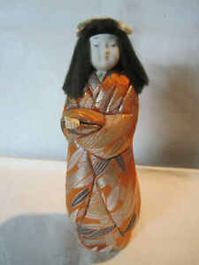 Vintage Japanese Kimekomi doll in kimono with outstretched hand