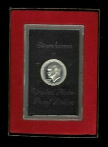 1974 S EISENHOWER PROOF DOLLAR IN THE BROWN BOX. HAS COMMON HALO AROUND IKE
